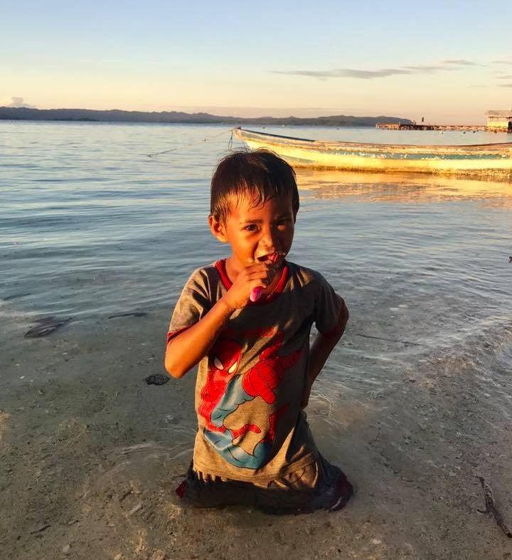 Child Brushing Teeth in Raja Ampat